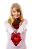 Woman in woolen gloves holding red heart, symbol of love Royalty Free Stock Photos