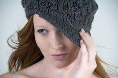 Woman with woolen hat Stock Photography