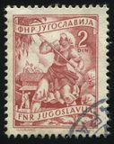 Woman worcing in the field. RUSSIA KALININGRAD, 12 NOVEMBER 2016: stamp printed by Yugoslavia, shows a woman worcing in the field, circa 1950 stock photography