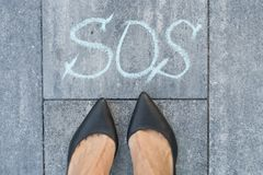 Woman and the word sos. The symbol is drawn in chalk Royalty Free Stock Images
