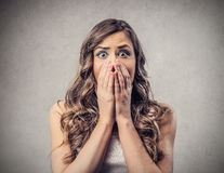 Woman without words. Amazed astonished woman covering her mouth with her hands Royalty Free Stock Photo