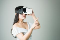 Woman wore a virtual reality headset that simulates, the reality and looked up to see what the virtual reality. Royalty Free Stock Images