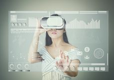 Woman wore a virtual reality headset that simulates, And touch screen technology graph. Royalty Free Stock Photography