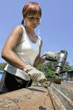 Woman and work. Woman with tool. Reparation window in garden Stock Image