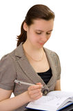Woman at work. Woman with pen and notebook, isolated Stock Photography