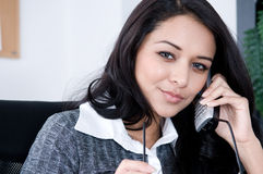Woman at Work. Attractive woman at her Desk. Shot with Hi Res Camera stock photos