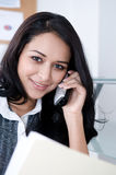 Woman at Work. Attractive woman at her Desk. Shot with Hi Res Camera royalty free stock photo