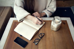 Woman work in cafe, notepad in a restaurant near window lunch time with coffee. Woman work in cafe, notepad in a restaurant near window lunch time Stock Photography
