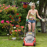 Woman work in garden Royalty Free Stock Image