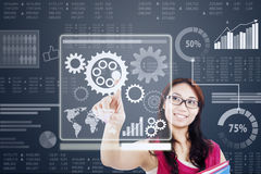 Woman work with gear on a futuristic interface Stock Photos