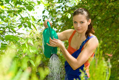 Woman work in her garden Stock Photo