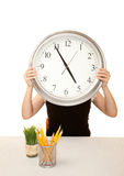 Woman at work holding large clock Royalty Free Stock Images