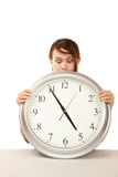 Woman at work holding large clock Royalty Free Stock Image