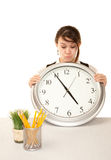 Woman at work holding large clock Royalty Free Stock Photography