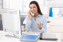 Woman at work on landline call Stock Photography