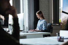 Woman work in office using computer. Looking aside. Photo of young woman work in office using computer. Looking aside Royalty Free Stock Photo