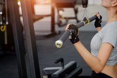 Woman work out in fitness gym. Woman work out in fitness gym withcropped shot stock image