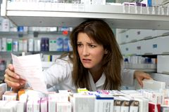 Woman work pharmacy Stock Images