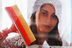 Woman at work, professional female cleaner cleaning and wiping w Royalty Free Stock Photos