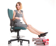 Woman work stoppage businesswoman relaxing legs up plenty of doc Royalty Free Stock Photo