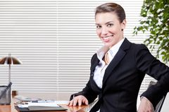 Woman at Work in Suit Stock Image