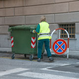 Woman at work. Urban recycling waste and garbage services Stock Image