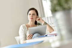 Woman at work using tablet. Businesswoman in office working on digital tablet Royalty Free Stock Photo