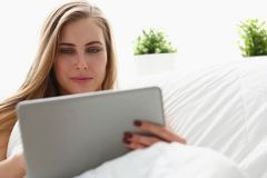 Woman work winh laptop stay in bed early morning Royalty Free Stock Photography