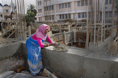 Woman worker. An Indian woman construction worker is working in a construction site Stock Images