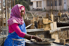 Woman worker. An Indian woman construction worker is working in a construction site Royalty Free Stock Photo