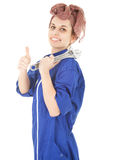 Woman worker in blue coveralls with thumb up Royalty Free Stock Image