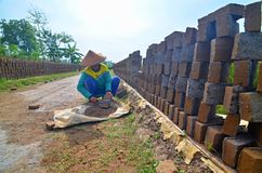 Woman worker in brick factory Royalty Free Stock Photo