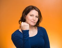 Woman worker, business employee showing fist Royalty Free Stock Images