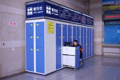 woman worker coin locker railway station Royalty Free Stock Images