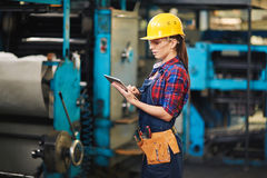 Woman worker in factory Royalty Free Stock Photos