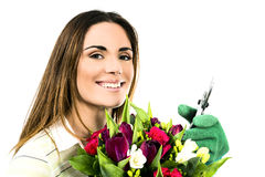 Woman worker with flowers. Stock Images