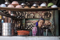 Woman worker get ready to open noodle shop. Royalty Free Stock Images