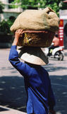 Woman worker in Hanoi. A woman carrying goods through the streets of Hanoi, Vietnam Stock Photography