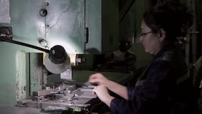 Woman worker on hard work in heavy industry stock footage