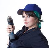 Woman worker holding a drill Stock Photography