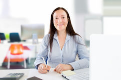 Woman worker at the office Royalty Free Stock Photos