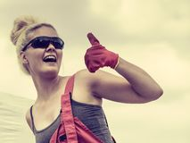 Woman worker showing thumb up royalty free stock photos