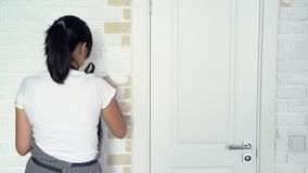 Woman worker using a brush painting walls in the apartment or house. Construction, repair and renovation.  stock footage