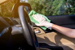 Free Woman Worker Using Cloth Cleaning On Car Door Panel,Cleansing Car Interior For Protection From Virus Disease Stock Photos - 182094653