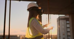Woman worker wearing reflective vest have experience with VR headset. Woman worker wearing reflective vest have experience with VR headset stock video footage