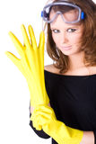 Woman worker with yellow rubber gloves Stock Photos