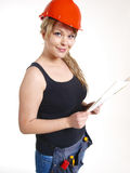 Woman working. Working woman with a hardhat and  lot off tools Stock Images