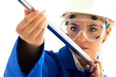 Woman working. Young blond girl with aluminum tube Stock Photos