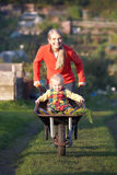 Woman working on allotment with child Royalty Free Stock Photography