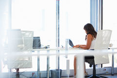 Woman working alone in an office Stock Photography